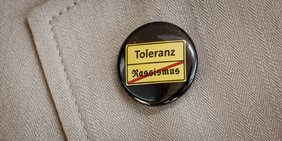 Button Toleranz